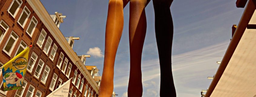 mannequin legs hanging from a beam